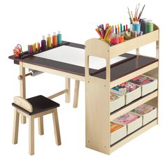 Child's Deluxe Art Center -- Would love to get one for Alex, but it costs $252.39. Ouch! Would be pretty easy to build something similar... craft paper rolls are available at Ikea