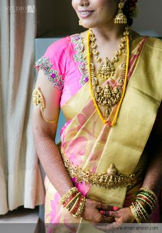 South Indian bride. Gold Indian bridal jewelry.Temple jewelry. Jhumkis.Pink and gold silk kanchipuram sari.Braid with fresh jasmine flowers. Tamil bride. Telugu bride. Kannada bride. Hindu bride. Malayalee bride.Kerala bride.South Indian wedding.