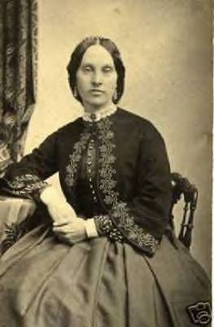 Victorian Civil War lady with lovely trimmings on her beautiful jacket