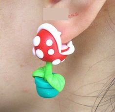 A Pair of Cute Super Mario Piranha Plant Chomper Earrings Stainless Steel Post / Studs Special for Sensitive Ears. $12.99, via Etsy.