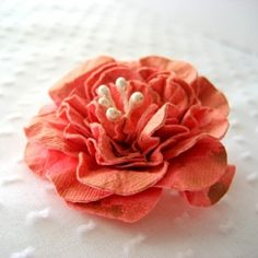 paper flower Just cut out the shapes, poke a brad through the middle, spritz with water, scrunch and dry by glenda