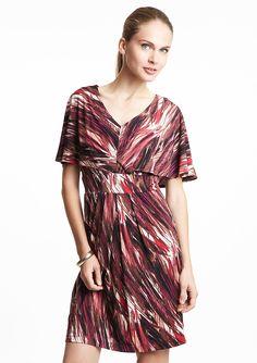 Arc waist. capelet dress balances.