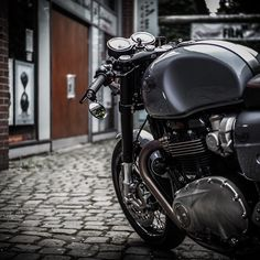 The beauty of a nobel bike between old industrial walls #caferacer #classicbikeraisch #triumph #bikesofinstagram #classic #custom #thruxton #bonneville #scrambler #t120 #ohlins #motorcycle #caferacerculture #triumphthruxton #triumphscrambler #bobber #triumphbonneville #thruxton1200 #thruxtonr #bonnevillet120 #streettwin #triumphstreettwin #bonnie #t100 #industrial #handcrafted