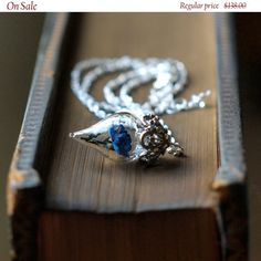 ON SALE Rare Blue Rose Necklace Tiny Flower by WoodlandBelle