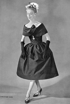 Dorothy in silk-wool blend cocktail dress by (Yves Saint Laurent) Christian Dior, shoes by Roger Vivier, 1958