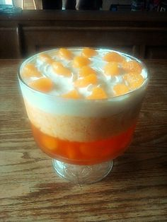 Creamsicle Jello Salad. Three layers of yum. Orange jello, with mandarin oranges, followed by orange jello/cool whip/tapioca layer, and topped with cool whip. Garnished with mandarin oranges. Full recipe on Lost and Found.
