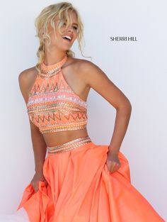 Step out in vivaciously vibrant style in the Sherri Hill 50310 two-piece prom dress. https://www.pinterest.com/behzadj/jovani-prom-dresses/ and https://www.pinterest.com/behzadj/blush-prom-dresses/ for other two-piece prom dresses. The Sherri Hill line is selling out fast.