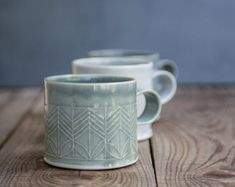This elegant coffee cups will make your mornings brighter!  Light blue coffee mug in a great size for coffee lovers, adorned with geometric pattern in modern design. This modern hand build tea cup is just at the right size for your evening herbal tea. Perfect for a cozy snuggle on the couch or in bed with espresso or hot chocolate. Made of folded clay sheets stamped with geometric pattern. Dipped in Light blue Matt glaze, burned to high temperature.  SET OF FOUR  > 3 tall. 3 diameter…
