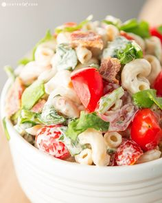 The fabulous flavors of a BLT come together in this BLT Pasta Salad with spinach, crispy bacon, and grape tomatoes tossed in a simple dressing.