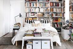 An artfully disheveled bookcase is one of the hipster home trends we love. It's not mess, it's er... art.