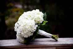 Hydrangeas may seem more expensive but even if out-of-season and a cost of perhaps $5 each, this bouquet only has 6 stems plus so easy for a do-it-yourself bride to create.