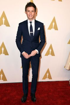 …and the style successes continued at the 87th Academy Awards Nominee Luncheon, where Redmayne plumped for his go-to hue (navy) in this slim-fitted, Saint Laurent suit. The key takeaway? Eddie knows that minimal suits can be dressed-up with a simple silver tie pin and plain pocket square.