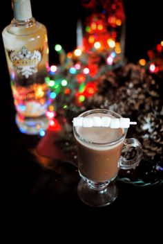Iced Cake Cocoa drink recipe: 1 oz Smirnoff Iced Cake flavored vodka, 10 oz hot water,  1 package Hot Cocoa Mix. #HotCocoa #IcedCake #Smirnoff #Holidays #Christmas #cocktails