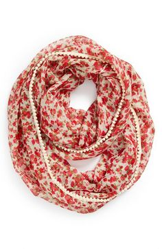 This infinity scarf is so cute! Adore the floral print and pompom trim.