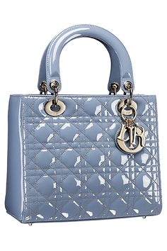 9e5129cd29b0 I t was in London last May when I saw the most gorgeous patent baby blue  Lady Dior bag with a greyish color at Harrods