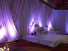 Uplighting on the drapery  Vivid Experiences by Angela Proffitt Located at the Embassey Suites Murfreesboro Photographed by Divine Images