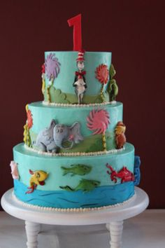 three tier birthday cake.  Dr. Seuss , one fish two fish, horten, cat in the hat , the lorax