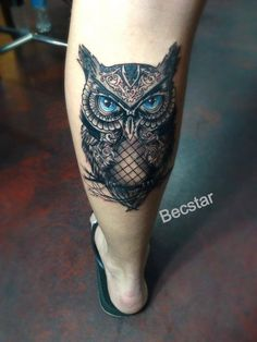 Blue eyed owl tattoo