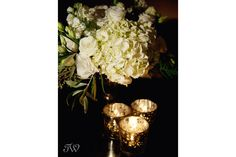 White hydrangea and lisianthus centrepiece in a gold mercury vase.  Flowers by Janie- Calgary Wedding Florist www.flowersbyjanie.com  Photo: @tarawhitphoto