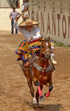 Charro Ranch in San Antonio has over 60 years of tradition, art, culture, and history. Skilled woman riding side saddle..wow!