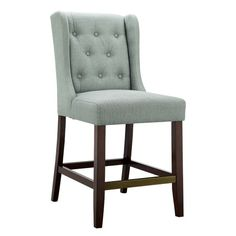 This beautiful button-tufted counter stool is upholstered in a beautiful woven fabric that coordinate perfectly with several different decor styles.