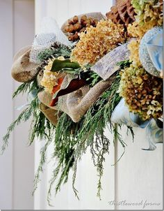 20 Decorating Ideas from the Southern Living Idea House: Christmas swags with burlap, dried hydrangeas, evergreens, magnolia leaves, pinecones. Christmas Mantels, Christmas Love, Winter Christmas, All Things Christmas, Christmas Wreaths, Christmas Crafts, Christmas Decorations, Christmas Ideas, Christmas Budget