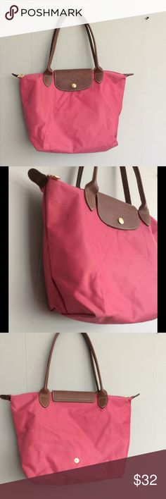 """Pink Longchamp tote 14.5""""X10"""" good used condition very minor wear on the corners and some marks on the side see pic. Authentic. Longchamp Bags Totes"""