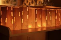 "DIY: Luminary Cityscape Bags - paper punch used to create ""windows"" for these paper skyscrapers #decor #crafts"
