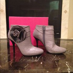 Host PickShoedazzle Flower Booties These beauties are the reason I joined Shoedazzle. Beautiful shade of gray with a big flower on the outside, zipper on the inside, all man made materials, 4 inch heels. Shoe Dazzle Shoes Ankle Boots & Booties