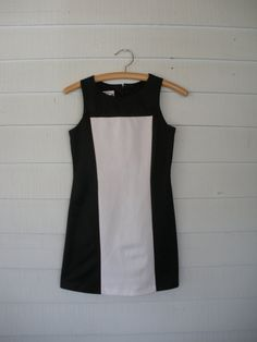 """Sleek mod mini, a la 90s. Poly construction, graphic pattern, made by A. Byer. Will fit an XS, or a smaller small. Bust will fit up to 32"""" and waist 26""""."""
