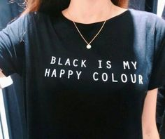 "Black Is My Happy Colour T-Shirt - Rebel Style Shop--- Nothing screams ""grunge"" more than the color black. Show the world your love for everything dark with this simple, yet versatile piece. Pair it with leather pants for a biker look or a plaid skirt and beanie for a soft grunge look. Either way, make sure you wear it with attitude."