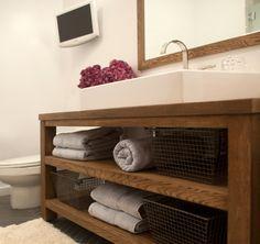 Modern rustic bathroom with gray herringbone slate tile floor and wall-mounted ...