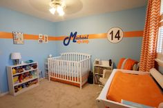 The Totally Orange Stripe making a colorful debut in this orange and blue nursery!