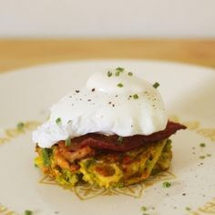 Leek fritters, bacon, a poached egg, and lemon sour cream make for a delicious breakfast or lunch!