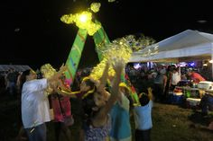 Amber lights on the bubbles at the Muscogee (Creek) Nation Festival Big Bubbles, World's Biggest, Solar Power, Amber, Entertainment, Lights, Solar Energy, Lighting, Ivy