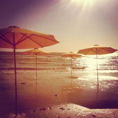 shooting on the beach in malibu... love the umbrella backdrop