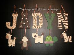 I could spell the name and print it out then hang the animal wood designs from the frame? Baby Girl Room Decor, Baby Nursery Decor, Hanging Letters, Wooden Letters, Jungle Baby Room, Jungle Theme, Baby Name Letters, Creation Deco, Safari Nursery
