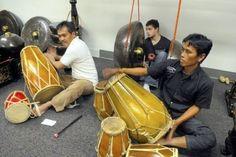 Devra playing in the gamelan orchestra.