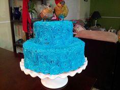 Love birds blue rosettes cake