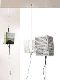 ONCE UPON A LIGHT by Mogg / Lightness, suggestion and a little bit of magic for this lamp and a book holder assembled together. A thin presence with a strong value. Ideas and memories linked together in a light beam / http://www.mogg.it/Prodotti/Accessories/ONCE-UPON-A-LIGHT/   #mogg #moggdesign #EmanueleMagini #lamp #ceilingtofloor #bookholder #lighting #italianfurniture #interiordesign #italian #furniture #interior #design