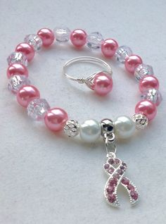 Handmade Breast Cancer Awareness Stretch Bracelet and Wire Wrapped Ring Set - Pink Ribbon - Awareness Jewelry   https://www.etsy.com/listing/251747903/handmade-breast-cancer-awareness-stretch