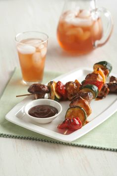 """BBQ Grilled Chicken Kabobs -- BBQ sauce, tender chunks of chicken and your choice of fresh vegetables make this healthy living kabob recipe a shoo-in for """"new family favorite."""" Ready for the dinner table in just 30 minutes time!"""