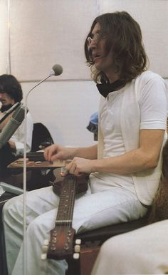 """John playing Hawaiian steel slide guitar in """"For You Blue"""" during movie Let It Be."""