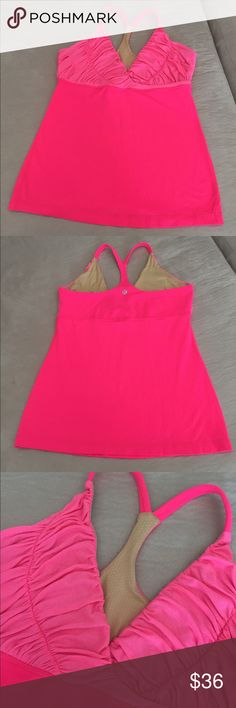 Lululemon Workout Top Lululemon Workout Top. Size 10. Bright pink with ruching on front. Built in bra (does not include removable bra pads). EXCELLENT CONDITION!! No trades. lululemon athletica Tops Tank Tops