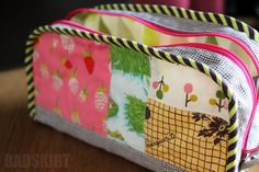 Zipper Case by badskirt, tutorial by craft passion, briar rose fabric with other goodness.  :)