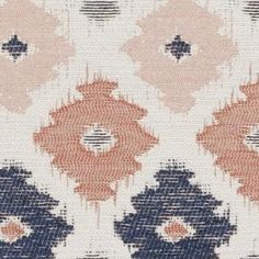 A modern geometric ikat upholstery fabric in coral, tangerine and navy blue on a woven ivory background. This heavyweight woven fabric is