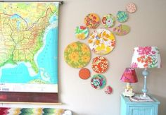 A map, plates, and colorful lamp shades