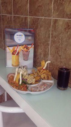 Ronda Marina con Ceviche, Arroz con Mariscos, Chicharrones mixtos y Causa de cangrejo.