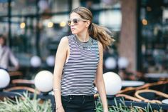 Blogger Maristella of A Constellation in a stripe top and shorts look