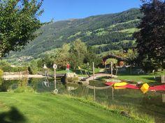 Außenanlage vom Wanderhotel Kirchner in Bramberg. Eigener Badesee mit traumhaften Ambiente. Berg, Golf Courses, Travel, Bike Rides, Summer Vacations, National Forest, Viajes, Destinations, Traveling